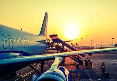 Aeroplane with the sun setting behind it