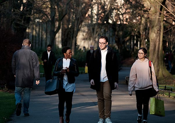 DIFC Students walking and smiling through a park