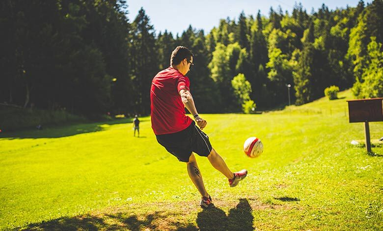 Man kicking a football