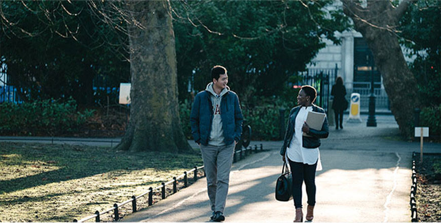 DIFC students walking through a park